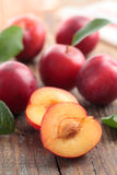 Plums. On the rustic table Royalty Free Stock Photography