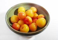 Plums. A bowl full of plums Stock Photos