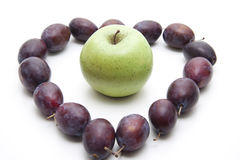 Plums with apple Royalty Free Stock Photography