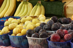 Plums and bananas Royalty Free Stock Photography