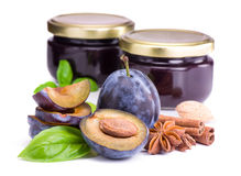 Plums with basil leaves,anise and jam in glass jars Royalty Free Stock Photo
