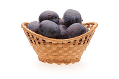 Plums in basket. On white background Stock Image