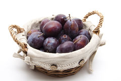 Plums in the basket Royalty Free Stock Image