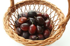 Plums in basket Stock Image