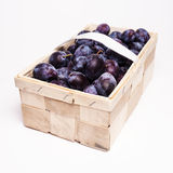 Plums in basket Stock Images