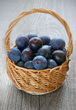 Plums in basket Stock Photography