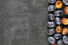 Plums on black board. Close up. Modern photography stock photo