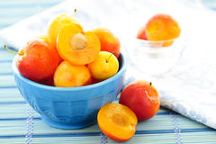 Plums in bowl Stock Photo