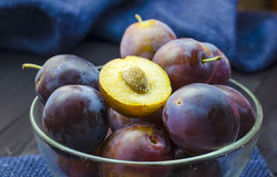 Plums in a bowl. Ripe fresh plums in a bowl on the table Stock Image