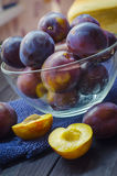Plums in a bowl. Ripe fresh plums in a bowl on the table Stock Images