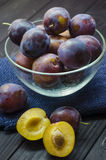 Plums in a bowl. Ripe fresh plums in a bowl on the table Stock Photography