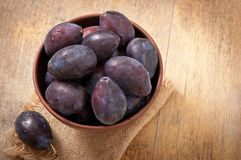 Plums in bowl Stock Image