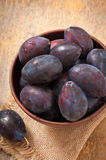 Plums in bowl Royalty Free Stock Images