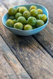 Plums. Bowl of plums on a wooden table Stock Photo