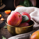 Plums in bronze bowl Stock Photography