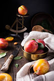 Plums in bronze bowl Royalty Free Stock Image
