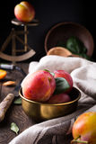Plums in bronze bowl Stock Images