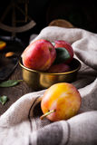 Plums in bronze bowl Royalty Free Stock Images
