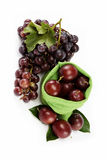 Plums and a bunch of grapes isolated. Royalty Free Stock Photos