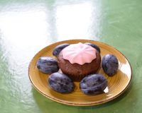 Plums cake on a plate. Tasty smack Royalty Free Stock Photography