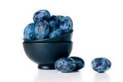 Plums in a ceramic bowl Stock Photo