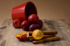 Plums and cinnamon Stock Photos