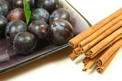 Plums and cinnamon Royalty Free Stock Images