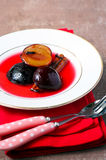 Plums with cinnamon and cloves Royalty Free Stock Photo