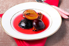 Plums with cinnamon and cloves Royalty Free Stock Image