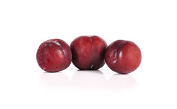 Plums close up isolated on white background Stock Photo