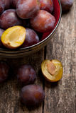 Plums close up simple composition. On the old weathered wood royalty free stock photography