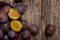 Plums close up simple composition. On the old weathered wood royalty free stock image
