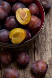 Plums close up simple composition. On the old weathered wood stock images