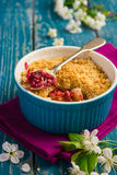 Plums crumble pie on blue ramekin Stock Photography
