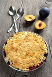 Plums crumble pie. On wooden background royalty free stock photos