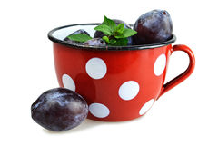 Plums in the cup Stock Photos