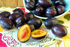 Plums, cut in half Royalty Free Stock Image