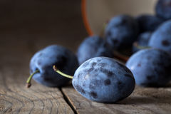Plums on a dark wooden table background Stock Photo