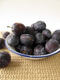 Plums in a enamel bowl Royalty Free Stock Images