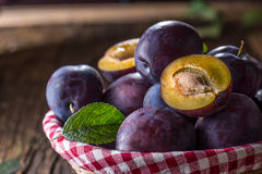 Free Plums. Fresh Juicy Plums In A Bowl On A Wooden Or Concrete Board Royalty Free Stock Photography - 98107377