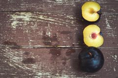 Plums. Fresh Plums  on a wooden board Stock Photos