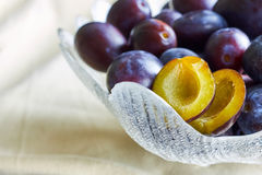 Plums in fruit bowl. On table. Copy space Stock Photos