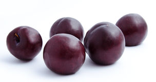 Plums fruit isolated on a white Stock Photos