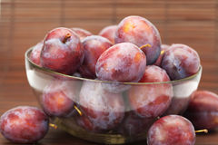 Plums in a glass bowl Royalty Free Stock Photo