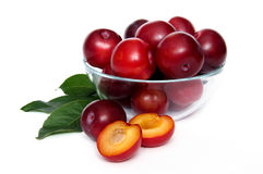 Plums in a glass bowl. Over white background Stock Photography