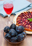 Plums in glass bowl Stock Photography