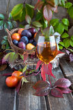 Plums and glass of  wine Royalty Free Stock Images