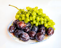 Plums and grapes. Plums and grapes on isolated Royalty Free Stock Photos