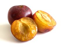 Plums isolated Stock Images