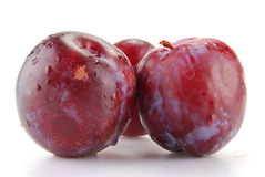 Plums isolated on white. Background Stock Photo